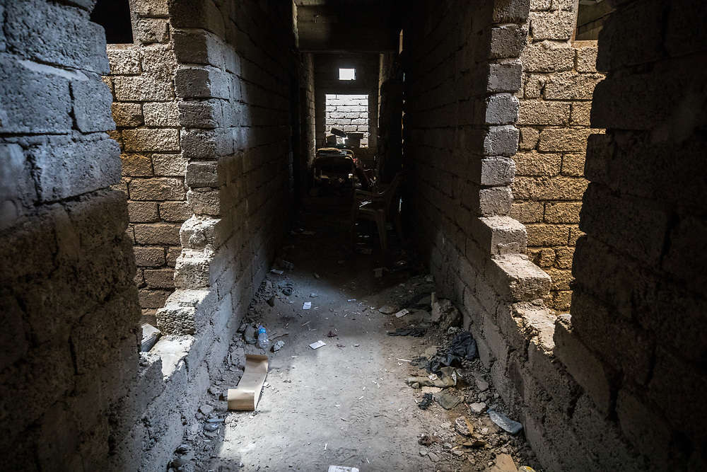 The narrow streets in the old city that can make fighting so difficult. The holes in the walls were created by ISIS fighters to move between buildings and avoid coalition airstrikes. West Mosul, Iraq. May 9, 2017. (Photo by Gabriel Romero ©2017)