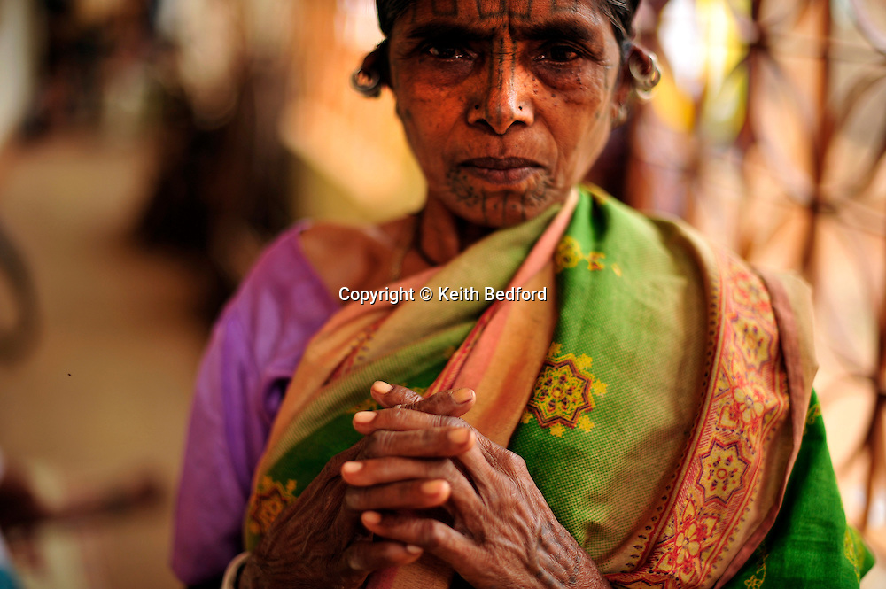 An Indian woman of tribal decent who converted to Christianity prays during Good Friday services at a camp for displaced Christians April 10, 2009 in the town of Mondesore in the state of Orissa, India. Tensions remain high in the area several months after violence by Hindu fundamentalist towards the Christian minority  forced thousands from their homes and leaving several churches and homes destroyed.