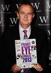 Private Eye editor Ian Hislop and illustrator Nick Newman (not in frame) sign copies of the Private Eye Annual 2013 and Private Eye: A Cartoon History AT Waterstones, Leadenhall Market, Whittington Avenue, London, United Kingdom. Tuesday, 10th December 2013. Picture by Nils Jorgensen / i-Images