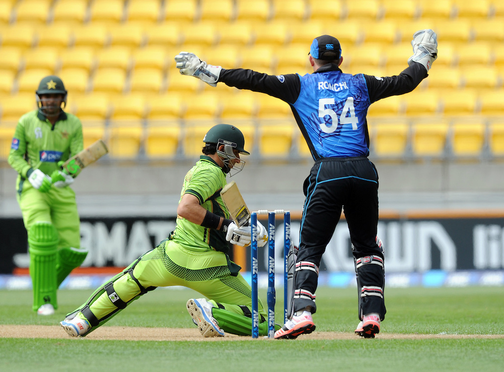 Pakistan's Misbah-ul-Haq attempts a reverse swing in front of New Zealand's Luke Ronchi in the 1st One Day International cricket match at Westpac Stadium, New Zealand, Saturday, January 31, 2015. Credit:SNPA / Ross Setford