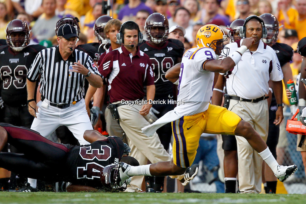 Sep 18, 2010; Baton Rouge, LA, USA;  LSU Tigers quarterback Jordan Jefferson (9) runs away from Mississippi State Bulldogs linebacker K.J. Wright (34) during the first half at Tiger Stadium.  Mandatory Credit: Derick E. Hingle