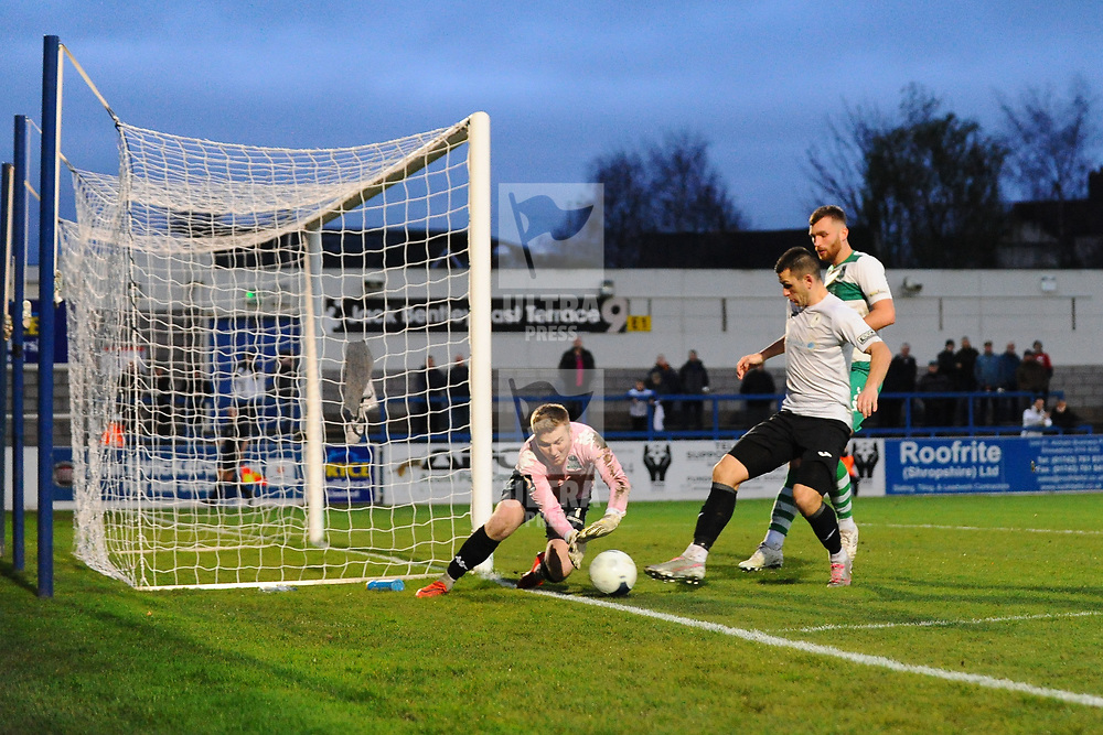 TELFORD COPYRIGHT MIKE SHERIDAN Aaron Williams of Telford is denied by Farsley keeper Kyle Trenerry during the Vanarama Conference North fixture between AFC Telford and Farsley at the New Bucks head Stadium on Saturday, December 7, 2019.<br /> <br /> Picture credit: Mike Sheridan/Ultrapress<br /> <br /> MS201920-033