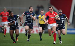 Saracens' Andrew Fenby gets away from Sale Sharks's Paolo Odogwa (left) during the Aviva Premiership match at The AJ Bell Stadium, Sale.