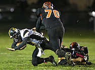 Midland quarterback Hagan Ackley (15) is sacked by Springville's Selby Ballantyne (70) and Drew Hoskins (71) during their game at Allison Field in Springville on Friday October 19, 2012. Midland defeated Springville 30-29.