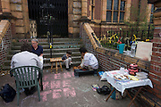 Campaigners locked out of the closed Carnegie Library play chess outside, in Herne Hill, south London on 7th May 2016. For ten days, members of the community in the south London borough occupied their important resource for learning and social hub for the weekend. But after a long campaign by locals, Lambeth have gone ahead and closed the library's doors because they say, cuts to their budget mean millions must be saved. A gym is planned to replace the working library and while some of the 20,000 books on shelves will remain, no librarians will be present to administer it. London borough's budget cuts mean four of its 10 libraries will either close, move or be run by volunteers.