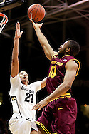 February 16th, 2013 Boulder, CO - Colorado Buffaloes junior forward André Roberson (21) elevates to block a shot attempt by Arizona State Sun Devils junior guard Evan Gordon (10) during the NCAA basketball game between the Arizona State Sun Devils and the University of Colorado Buffaloes at the Coors Events Center in Boulder CO