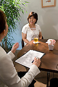 "Etsuko Satake (l) critiques a simulation class between student ""Keiko"" (r) and an unidentified coach (not pictured) at Infini, a school training marriage hopefuls how to hook Mr. or Mrs. Right in Tokyo, Japan on Sep. 9, 2010."