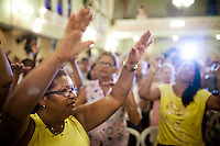 "Catholic worshippers attend a ""cure and liberty"" mass, in the north zone, at the Parish of Our Lady of Graces, in Rio de Janeiro, Brazil, on Thursday, March 7, 2013.  The church is known for charismatic services, a movement which originated in the late 1960s, uses methods similarly to Evangelicalism using more audience participation and an all-around brighter tone where parishioners can sing and dance to songs. It's can also be referred to as ?Evangelical Catholicism?."