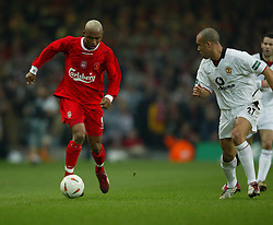 CARDIFF, WALES - Sunday, March 2, 2003: Liverpool's El-Hadji Diouf takes on Manchester United's Mikael Silvestre during the Football League Cup Final at the Millennium Stadium. (Pic by David Rawcliffe/Propaganda)