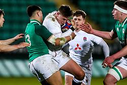 Tom Roebuck of England U20 is tackled by Dan Kelly of Ireland U20 - Rogan/JMP - 21/02/2020 - Franklin's Gardens - Northampton, England - England U20 v Ireland U20 - Under 20 Six Nations.