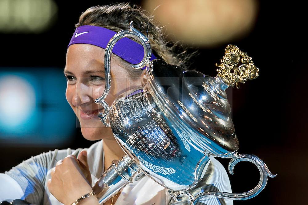 © Licensed to London News Pictures. 26/01/2013. Melbourne Park, Australia. Victoria Azarenka hugs her winner trophy while smiling during the Womens Final between Victoria Azarenka and Li Na of the Australian Open. Photo credit : Asanka Brendon Ratnayake/LNP