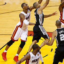 Jun 6, 2013; Miami, FL, USA; San Antonio Spurs point guard Tony Parker (9) lays the ball up past Miami Heat center Chris Bosh (1) in the first quarter during game one of the 2013 NBA Finals at the American Airlines Arena. Mandatory Credit: Derick E. Hingle-USA TODAY Sports