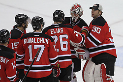 Apr 3; Newark, NJ, USA; The New Jersey Devils congratulate New Jersey Devils goalie Johan Hedberg (1) after their 3-1 win over the New York Islanders at the Prudential Center.  The Devils defeated the Islanders 3-1.