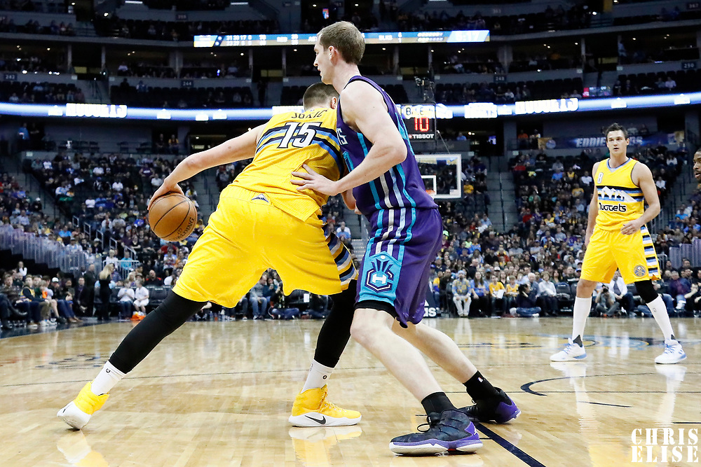 04 March 2017: Charlotte Hornets center Cody Zeller (40) defends on Denver Nuggets forward Nikola Jokic (15) during the Charlotte Hornets 112-102 victory over the Denver Nuggets, at the Pepsi Center, Denver, Colorado, USA.