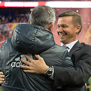 Mar 19, 2016; Harrison, NJ, USA; Red Bulls head coach Jesse Marsch embraces  Houston Dynamo head coach Own Coyle in the first half at Red Bull Arena. Red Bulls defeat the Dynamo 4-3. Mandatory Credit: William Hauser-USA TODAY Sports