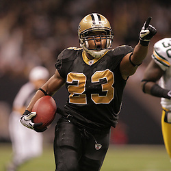 2008 November, 24: New Orleans Saints running back Pierre Thomas (23) runs away from Green Bay Packers safety Nick Collins (36) as he heads to the endzone increasing the Saints lead to 51-29 during a Monday Night Football game between the Green Bay Packers and the New Orleans Saints at the Louisiana Superdome in New Orleans, LA.