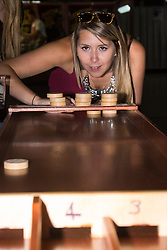 Olympia, London, August 9th 2015. Hundreds of real ale lovers attend the Campaign for Real Ale  Great British Beer Festival at London's Olympia Exhibition Centre, where dozens of independent breweries demonstrate the diversity of British brewed beers. PICTURED: A woman enjoys a traditional pub game.