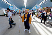 An actor dressed in period costume as a priest during the Edo festival at Haneda International Airport terminal, Tokyo, Japan. Friday August 26th 2016. The 3 day festival runs from August 26th to August 28th at Tokyo's second International airport. Actors dressed as samurai, geisha and ninja will greet passengers and visitors to the terminal and put on shows and parades of traditional music and dance. Haneda International airport has an Edo theme. Edo is the old name for Tokyo in the time of the samurai