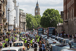 Image ©Licensed to i-Images Picture Agency. 11/06/2014. London, United Kingdom. Drivers of London black cabs \'gridlock\' the area around Whitehall. Drivers of black cabs and The Knowledge Taxi motorcycles \'gridlock\' the area around Trafalgar Square and government buildings on Whitehall in a protest against the Uber app-based service. Trafalgar Square. Picture by Daniel Leal-Olivas / i-Images