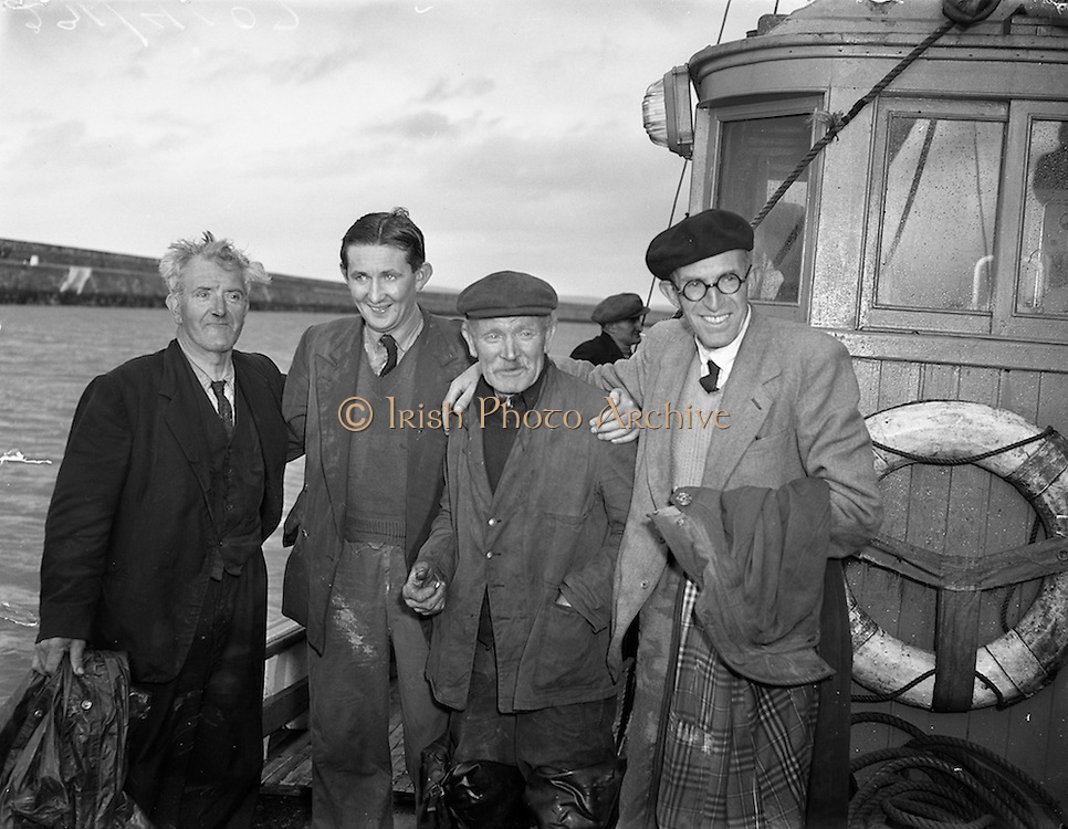 """31/08/1953<br /> 08/31/1953<br /> 31 August 1953 <br /> Rescue at sea by trawler """"Uncle Pat"""" of three Co. Dublin men who spent a night in a row boat at Dun Laoghaire.  The Captain of the trawler (third from left) with the lucky trio."""