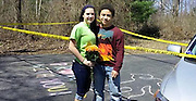 'I'm dying to go to prom with you': Teen poses as chalked-off dead body during outrageous proposal to police chief's daughter before she moves away in month<br /> <br /> A Maryland high school junior wanted to knock his senior girlfriend dead with a killer 'promposal' so he decided he would put up police tape around her driveway and pose as a crime scene cadaver. <br /> Elijah Williams and Marie Kasten, both 16, have dated for two years and attend Manchester Valley High School but had never gone to prom together.<br /> Kasten, the daughter of the former chief deputy of the Carroll County Sheriff's Office, is moving away in about a month because her dad Phil got a job as a police chief in Vermont. <br /> <br /> Williams wanted to ask Kasten to prom in a special way due to her family's impending departed and his sister Alexes, 20, came up with a police-themed plan, the Carroll County Times reported.<br /> In order to pull off the staged scene, brother and sister enlisted the help of their mother and Kasten's mom to get their target out of the house so they would have time for the caper. <br /> While the mothers took Kasten grocery shopping before Easter, Williams and his big sister put up the police tape and drew a while chalk outline of his body. <br /> When she pulled up the house and saw her boyfriend lying in the driveway next to a rainbow-colored message reading, 'I'm dying to go to prom with you', Williams was powerless to say no. <br /> They attended the prom on Saturday night at the Wyndham hotel in Gettysburg, Pennsylvania. <br /> Williams said: 'I was really surprised. It meant a lot to me because my father is a police officer.' <br /> A Facebook commenter who saw the colorful proposal wrote: 'Beautiful way for a proposal. <br /> 'Very creative. Glad she said yes. Hope they had a BEAUTIFUL time. <br /> 'Such a BEAUTIFUL picture. I hope they night was just as BEAUTIFUL.'<br /> ©Marie Kasten/Exclusivepix Media