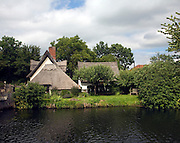 Thatched Bridge Cottage at Flatford, East Bergholt, Suffolk, England