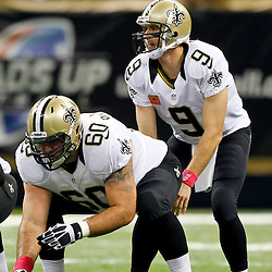 October 7, 2012; New Orleans, LA, USA; New Orleans Saints quarterback Drew Brees (9) lines up under center Brian De La Puente (60) during the first quarter of a game against the San Diego Chargers at the Mercedes-Benz Superdome. Mandatory Credit: Derick E. Hingle-US PRESSWIRE