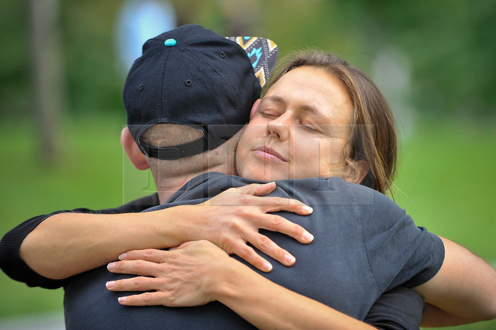 © Licensed to London News Pictures. 23/09/2017. London, UK. A couple share a hug after taking time to look at each other on Global Eye Contact Day during the UN International Week of Peace.  Sitting down and making eye contact for sixty seconds with another person is designed to improve human connection and a more peaceful world. Photo credit : Stephen Chung/LNP