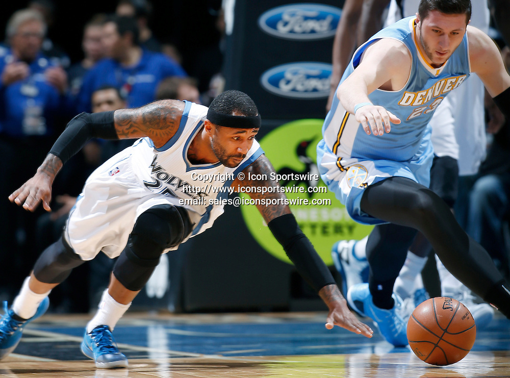 Jan. 5, 2015 - Minneapolis, MN, USA - Minnesota Timberwolves' Mo Williams (25) and Denver Nuggets' Jusuf Nurkic (25) fight for a loose ball during the first quarter on Monday, Jan. 5, 2015, at the Target Center in Minneapolis