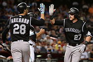 Apr 28, 2017; Phoenix, AZ, USA; Colorado Rockies infielder Trevor Story (27) is congratulated by teammate Nolan Arenado (28) after hitting a solo homer during the third inning against the Arizona Diamondbacks at Chase Field. Mandatory Credit: Jennifer Stewart-USA TODAY Sports