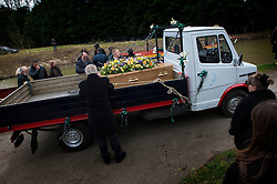 Funeral procession of boatman John Forth after it made its way through the locks on the Grand Union Canal in Long Itchington, near Southam, Warwickshire, England, UK.