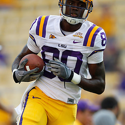 Sep 18, 2010; Baton Rouge, LA, USA;  LSU Tigers wide receiver Terrence Toliver (80) runs with the ball during warms ups prior to a game against the Mississippi State Bulldogs at Tiger Stadium.  Mandatory Credit: Derick E. Hingle