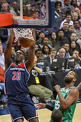 April 10, 2018 - Washington, DC, U.S. - WASHINGTON, DC - APRIL 10:  Washington Wizards center Ian Mahinmi (28) scores on a dunk against  Boston Celtics center Greg Monroe (55) on April 10, 2018 at the Capital One Arena in Washington, D.C.  The Washington Wizards defeated the Boston Celtics, 113-101.  (Photo by Icon Sportswire) (Credit Image: © Icon Sportswire/Icon SMI via ZUMA Press)