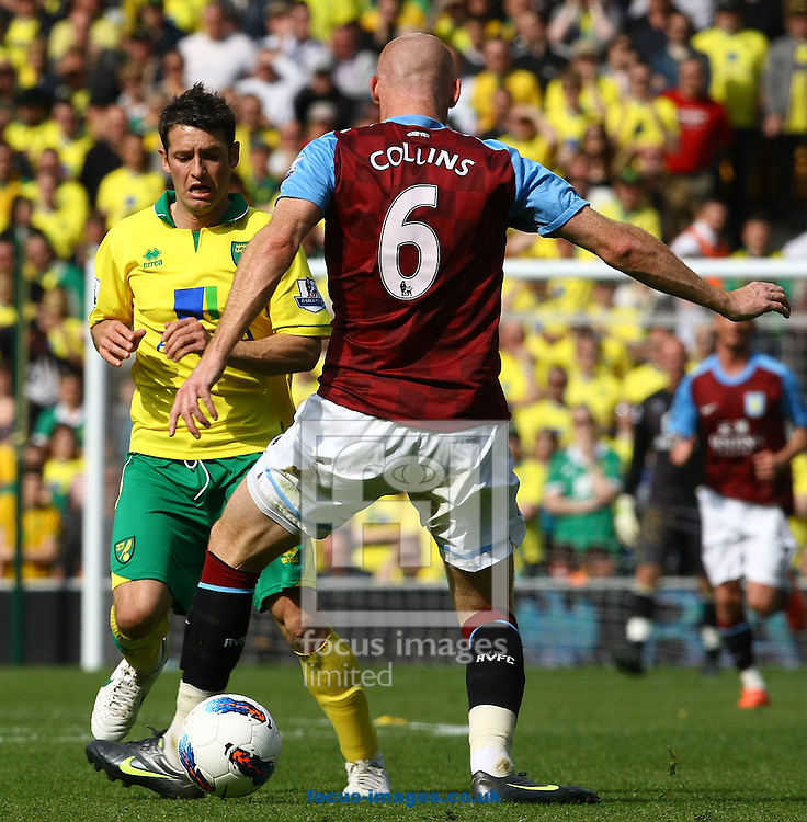 Picture by Paul Chesterton/Focus Images Ltd.  07904 640267.13/05/12.James Collins of Aston Villa and Wes Hoolahan of Norwich in action during the Barclays Premier League match at Carrow Road Stadium, Norwich.