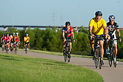 """Mayor Pro Tem Stephen Lindsey of Mansfield (yellow) leads the pack during the first  """"Elected Officials bike ride"""" along the Champion Trail in Irving, Texas on August 6, 2013. Riders included nearly 15 mayors and council members from around north Texas with the common goal to promote biking in their neighborhoods. (Cooper Neill / Texas Tribune)"""