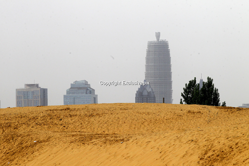 ZHENGZHOU, CHINA - MAY 04: (CHINA OUT) <br /> <br /> Photo shows mounds of sand beside Longhu Lake on May 4, 2014 in Zhengzhou, Henan Province of China. Zhengzhou, the capital city of north-central China's Henan Province, is currently a sandy mess. Officials wanting to create an artificial lake on the outskirts of the city have botched things up so bad that it's turned into a sprawling desert instead. The sand is everywhere about 10 meters high and covering an area as large as four football fields. Naturally, Zhengzhou's residents arent pleased. <br /> ©Exclusivepix