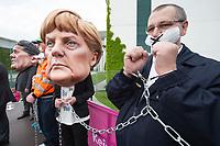 """01 MAY 2014, BERLIN/GERMANY:<br /> Angela-Merkel und Sigmar-Gabriel-Darsteller nehmen Mitglieder des dbb mit Handschellen an die Kette während einer Protest Performance des Deutschen Beamtenbundes, dbb, und des Marburger Bundes unter dem Motto """"So nicht, Frau Merkel und Herr Gabriel!"""" am 1. Mai, dem Tag der Arbeit, vor dem Budneskanzleramt<br /> IMAGE: 20140501-01-117<br /> KEYWORDS: Demo, Demonstration, Protest"""