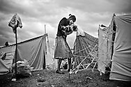 A woman holds her baby in a camp for those displaced by the recent earthquake in Petionville, outside Port-au-Prince, Haiti.