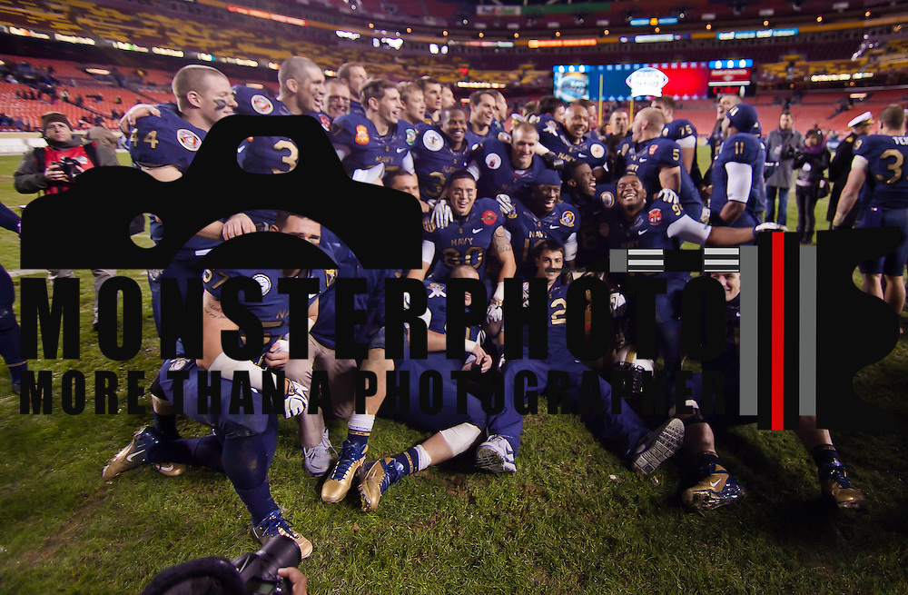 Navy players pose with the Thompson Cup Saturday, Dec. 10, 2011 at Fed EX field in Landover Md.<br /> <br /> Navy set the tone early in the game as Navy defeats Army 31-17 in front of 82,000 at Fed EX Field in Landover Md