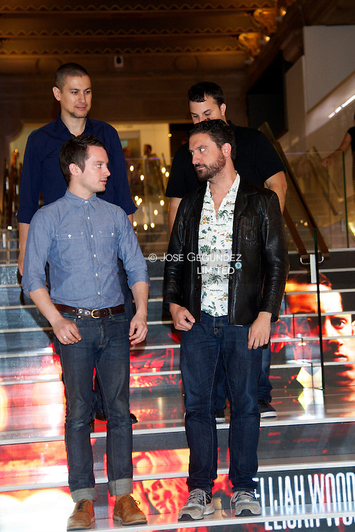 Elijah Wood, Director Eugenio Mira and Producer Rodrigo Cortes attend 'Grand Piano' photocall at Telefonica Foundation on October 14, 2013 in Madrid, Spain.
