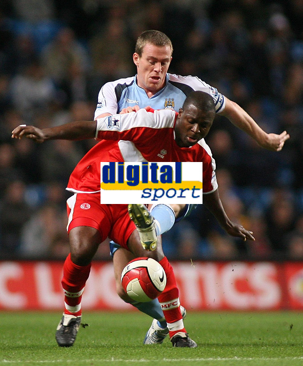 Photo: Paul Thomas.<br /> Manchester City v Middlesbrough. The Barclays Premiership. 30/10/2006.<br /> <br /> Richard Dunne (Blue) of Man City and Yakubu go for the ball.