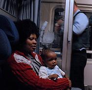 Roma, 11/01/2008: Madre e bimbo africani in uno scompartimento del treno.©Andrea Sabbadini