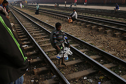 January 1, 2018 - Dhaka, Bangladesh - A plastic picker boy search ballets on a train track at Tejgaon Railway Station. (Credit Image: © Md. Mehedi Hasan via ZUMA Wire)