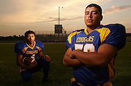 Photo by Alex Jones..Santa Maria Cougars: #4 Andrew De La Rosa (left), safety, #56 Victor Galan, nose guard.