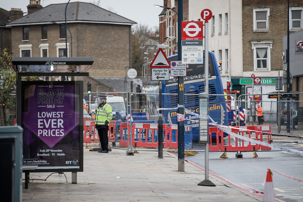 © Licensed to London News Pictures. 27/11/2016. London, UK. Lee High Road in Lewisham has been closed off and police declared a 'major incident' after a French tourist coach with 100 passengers on board fell into a sinkhole caused by a burst water mains, flooding a long stretch of the road including many local businesses. . Photo credit: Rob Pinney/LNP