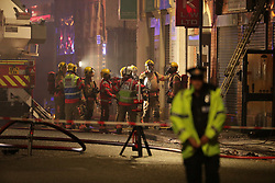 © Licensed to London News Pictures . 25/12/2017. Manchester, UK. At least eight fire engines, firefighters, police and ambulance crews respond to a fire, which was first reported just after 1am on Christmas day, on an industrial unit in Cheetham Hill in Salford . Photo credit: Joel Goodman/LNP