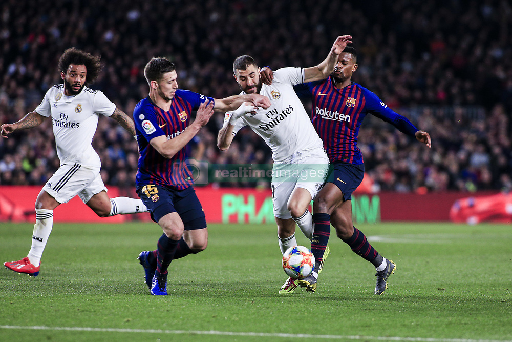 February 6, 2019 - Barcelona, Spain - 09 Karim Benzema of Real Madrid defended by 15 Lenglet of FC Barcelona and 02 Nelson Semedo of FC Barcelona during the semi-final first leg of Spanish King Cup / Copa del Rey football match between FC Barcelona and Real Madrid on 04 of February of 2019 at Camp Nou stadium in Barcelona, Spain  (Credit Image: © Xavier Bonilla/NurPhoto via ZUMA Press)