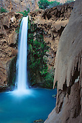 "The Havasupai tribe call it ""Mother of the Waters,"" and others call this 200-foot waterfall Mooney Falls (after a miner who fell to his death here), on Havasu Creek, in the Havasupai Indian Reservation, Arizona, USA."
