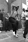 A man with a flat top dancing, Notting Hill Carnival, London, UK, 1980's