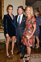 Left to right, CARA DELEVINGNE, MATTHEW BARZUN and BROOKE BARZUN at a party hosed by the US Ambassador to the UK Matthew Barzun, his wife Brooke Barzun and editor of UK Vogue Alexandra Shulman in association with J Crew to celebrate London Fashion Week held at Winfield House, Regent's Park, London on 16th September 2014.